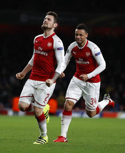 Arsenal's Mathieu Debuchy, left, celebrates scoring his sides first goal during the Europa League Group H soccer match between Arsenal and BATE Borisov at Emirates stadium in London, Thursday, Dec. 7, 2017.