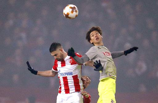 Cologne's Yuya Osako, right, challenges for the ball with Red Star's Damien Le Tallec during the Europa League group H soccer match between Red Star and Cologne on the stadium Rajko Mitic in Belgrade, Serbia, Thursday, Dec. 7, 2017.