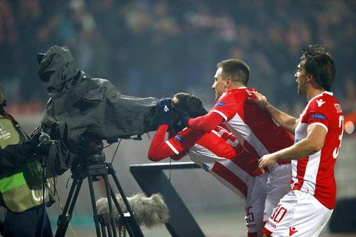 Red Star's Slavoljub Srnic, center, celebrates with teammates after scoring his side's opening goal during the Europa League group H soccer match between Red Star and Cologne on the stadium Rajko Mitic in Belgrade, Serbia, Thursday, Dec. 7, 2017.