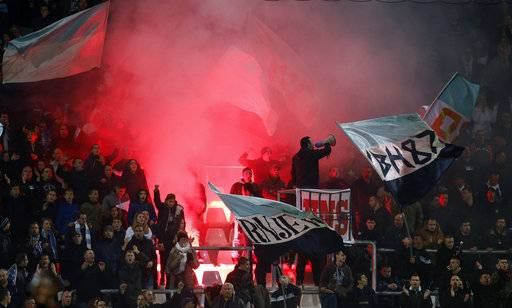 Rijeka supporters ignite flares during the group D Europa League soccer match between Rijeka and Milan, at the Rujevica stadium in Rijeka, Croatia, Thursday, Dec. 7, 2017.
