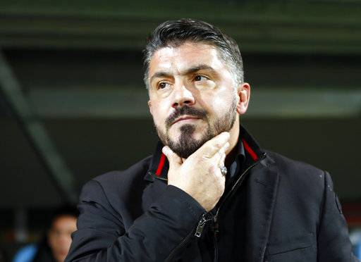 Milan head coach Gennaro Gattuso looks from the bench ahead of the group D Europa League soccer match between Rijeka and Milan, at the Rujevica stadium in Rijeka, Croatia, Thursday, Dec. 7, 2017.