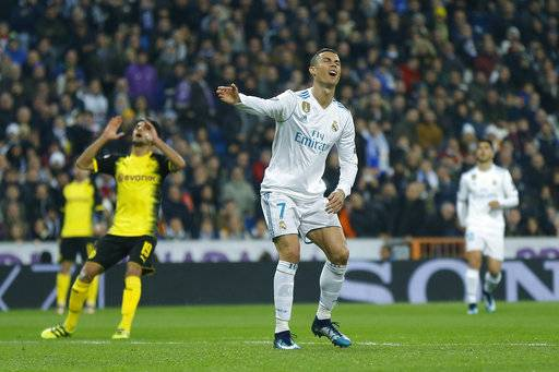 Real Madrid's Cristiano Ronaldo reacts during the Champions League Group H soccer match between Real Madrid and Borussia Dortmund at the Santiago Bernabeu stadium in Madrid, Spain, Wednesday, Dec. 6, 2017.