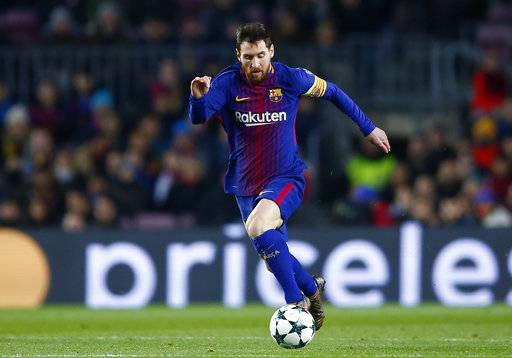 Barcelona's Lionel Messi runs for the ball during the Champions League Group D soccer match between FC Barcelona and Sporting CP at the Camp Nou stadium in Barcelona, Spain, Tuesday, Dec. 5, 2017.