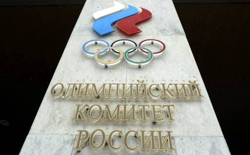 The logo of the Russian Olympic Committee is mounted at the entrance of the head office in Moscow, Russia, Wednesday, Dec. 6, 2017. The International Olympic Committee has barred the Russian team from competing at the Winter Olympics in Pyeongchang in February over widespread doping at the last  Winter Games in 2014.