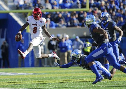 Louisville quarterback Lamar Jackson skips over the tackle of Kentucky cornerback Davonte Robinson during the second half of an NCAA college football game, Saturday, Nov. 25, 2017, in Lexington, Ky. Louisville won the game 44-17.