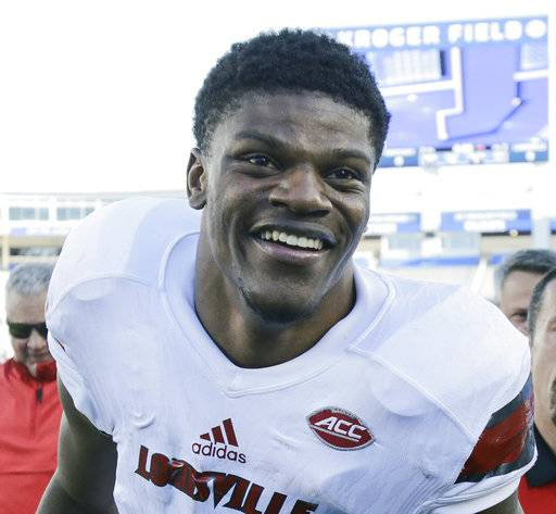 FILE - In this Nov. 25, 2017, file photo, Louisville quarterback Lamar Jackson smiles as he leaves the field after his team defeated Kentucky 44-17 in an NCAA college football game, in Lexington, Ky. Jackson was selected to the AP All-Conference ACC team announced Tuesday, Dec. 5, 2017.