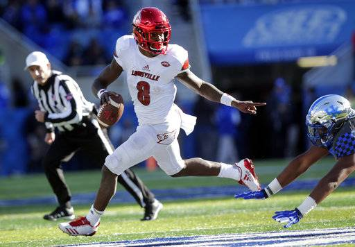 FILE - In this Nov. 25, 2017, file photo, Louisville quarterback Lamar Jackson (8) scrambles past Kentucky defensive tackle Kordell Looney during the second half of an NCAA college football game in Lexington, Ky. Jackson, Oklahoma quarterback Baker Mayfield and Stanford running back Bryce Love were chosen as finalists for the Heisman Trophy on Monday, Dec. 4, 2017.