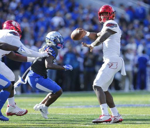 Louisville quarterback Lamar Jackson throws a touchdown pass to wide receiver Dez Fitzpatrick during the first half of an NCAA college football game against Kentucky, Saturday, Nov. 25, 2017, in Lexington, Ky.