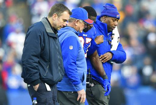 FILE - In this Sunday, Dec. 3, 2017, file photo, Buffalo Bills trainers assists cornerback Tre'Davious White (27) off the field after being injured on a late hit by New England Patriots tight end Rob Gronkowski  during the second half of an NFL football game, Sunday, Dec. 3, 2017, in Orchard Park, N.Y.
