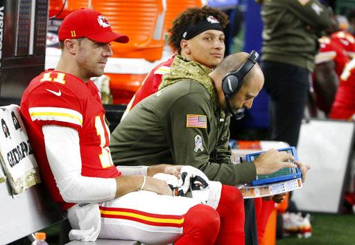 FILE - In this Nov. 5, 2017, file photo ,Kansas City Chiefs' Alex Smith, left, offensive coordinator Matt Nagy, center and quarterback Patrick Mahomes, rear, sit on the bench during an NFL football game against the Dallas Cowboys in Arlington, Texas. Chiefs coach Andy Reid turned over some of the playcalling duties to offensive coordinator Matt Nagy last week, and the immediate returns were good. But that wasn't enough for Reid to guarantee Nagy another shot this weekend.