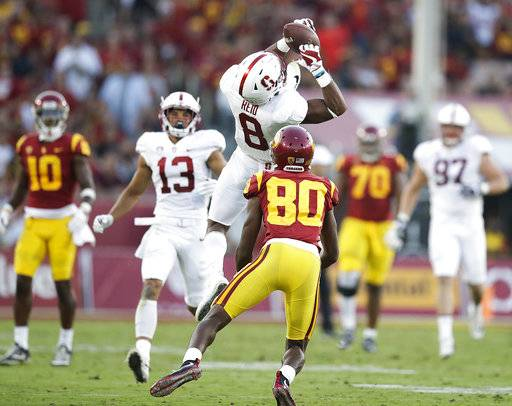 FILE - In this Sept. 9, 2017, file photo, Stanford safety Justin Reid, top, intercepts a pass against Southern California wide receiver Deontay Burnett during the first half of an NCAA college football game, in Los Angeles. Reid was selected to the AP All-Conference Pac-12 team announced Thursday, Dec. 7, 2017.