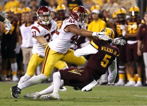 FILE - In this Oct. 28, 2017, file photo, Southern California linebacker Uchenna Nwosu (42) sacks Arizona State quarterback Manny Wilkins (5) during the second half of an NCAA college football game, in Tempe, Ariz. Nwosu was selected to the AP All-Conference Pac-12 team announced Thursday, Dec. 7, 2017.