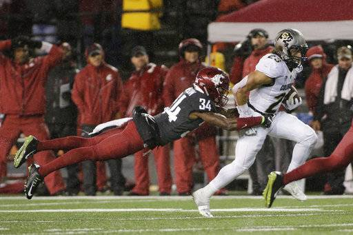 FILE - In this Oct. 21, 2017, file photo, Washington State safety Jalen Thompson (34) tackles Colorado running back Phillip Lindsay (23) during the first half of an NCAA college football game, in Pullman, Wash. Thompson was selected to the AP All-Conference Pac-12 team announced Thursday, Dec. 7, 2017.