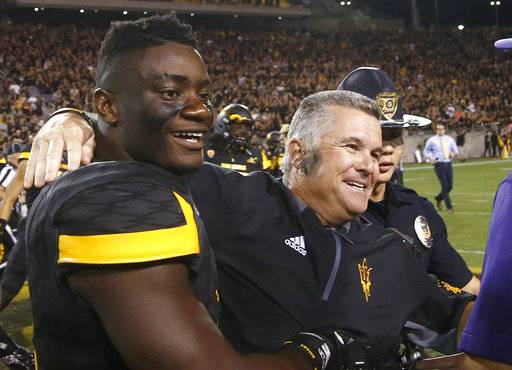 FILE - In this Oct. 14, 2017, file photo, Arizona State head coach Todd Graham, right, celebrates with linebacker Christian Sam, left, after an NCAA college football game against Washington, in Tempe, Ariz. Sam was selected to the AP All-Conference Pac-12 team announced Thursday, Dec. 7, 2017.