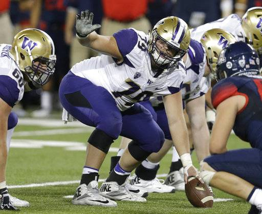 FILE - In this Sept. 24, 2016, file photo, Washington offensive center Coleman Shelton (79) gestures during the first half of an NCAA college football game against Arizona,  in Tucson, Ariz. Shelton was selected to the 2017 AP All-Conference Pac-12 team announced Thursday, Dec. 7, 2017.