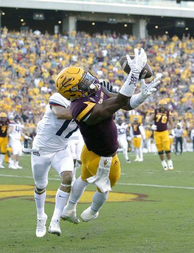 FILE - In this Nov. 25, 2017, file photo, Arizona State wide receiver N'Keal Harry (1) catches a touchdown pass in front of Arizona cornerback Jace Whittaker in the second half during an NCAA college football game, in Tempe, Ariz. Harry was selected to the AP All-Conference Pac-12 team announced Thursday, Dec. 7, 2017.