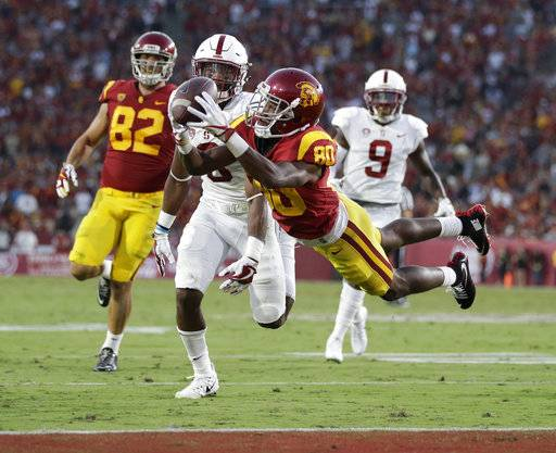 FILE - In this Sept. 9, 2017, file photo, Southern California's Deontay Burnett, center, catches a touchdown pass during the first half of an NCAA college football game against Stanford, in Los Angeles. Burnett was selected to the AP All-Conference Pac-12 team announced Thursday, Dec. 7, 2017.