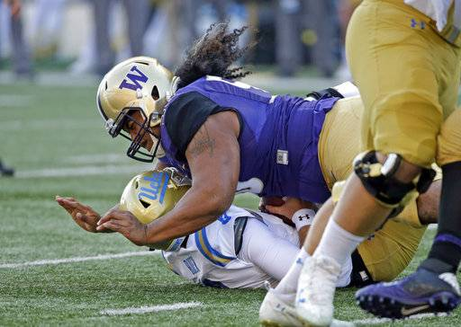 FILE - In this Oct. 28, 2017, file photo, Washington's Vita Vea sacks UCLA quarterback Josh Rosen in the first half of an NCAA college football game, in Seattle. Vea was selected to the AP All-Conference Pac-12 team announced Thursday, Dec. 7, 2017.