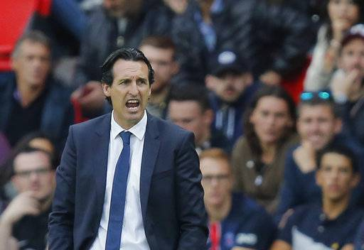 FILE - In this Saturday, Sept. 30, 2017 file photo, PSG's head coach Unai Emery reacts during a French League One soccer match Paris-Saint-Germain against Bordeaux at Parc des Princes stadium in Paris, France. Less than halfway through the season and speculation has already started as to who might replace Unai Emery as Paris Saint-Germain coach.