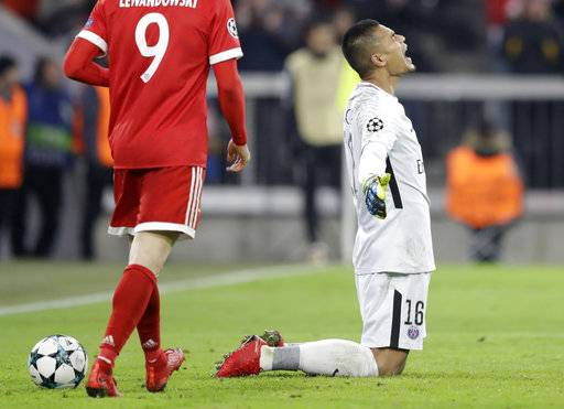PSG goalkeeper Alphonse Areola reacts after Bayern scored their third goal during the Champions League Group B soccer match between FC Bayern Munich and Paris Saint-Germain, at Allianz Arena stadium in Munich, Germany, Tuesday, Dec. 5, 2017.