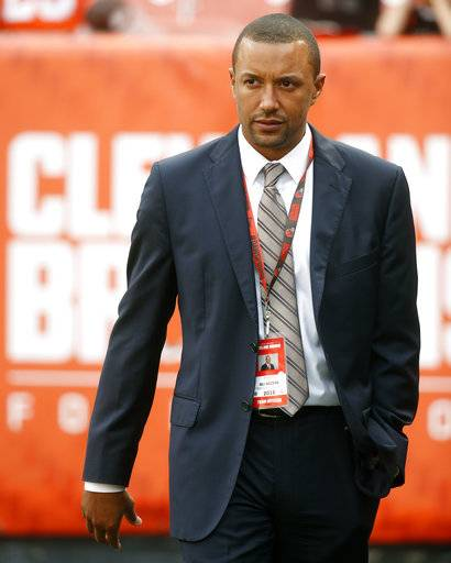 FILE - In this Sept. 1, 2016, file photo, Cleveland Browns acting vice president of football operations, Sashi Brown, walks the field during practice before an NFL preseason football game against the Chicago Bears, in Cleveland. A person familiar with the decisions says the Cleveland Browns have fired Sashi Brown, the club's vice president of football operations. Brown, who was named the team's top executive by owners Dee and Jimmy Haslam during an overhaul following the 2015 season, was relieved of his duties on Thursday, Dec. 7, 2017, said the person who spoke to the Associated Press on condition of anonymity because the team has not announced the move.