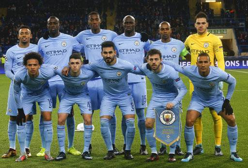 Manchester City players pose for a photo prior the Champions League group F soccer match between Manchester City and Shakhtar Donetsk at the Metalist Stadium in Kharkiv, Ukraine, Wednesday, Dec. 6, 2017.