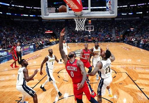 New Orleans Pelicans center DeMarcus Cousins (0) goes to the basket in the first half of an NBA basketball game against the Denver Nuggets in New Orleans, Wednesday, Dec. 6, 2017.