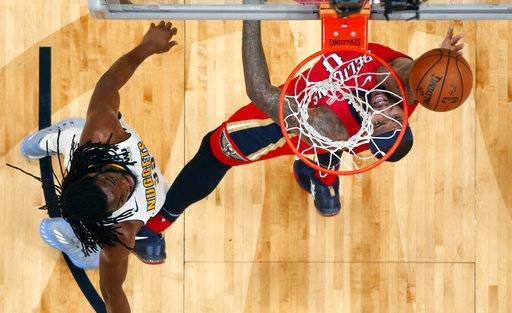 New Orleans Pelicans center DeMarcus Cousins (0) goes to the basket against Denver Nuggets forward Kenneth Faried, left, in the first half of an NBA basketball game in New Orleans, Wednesday, Dec. 6, 2017.