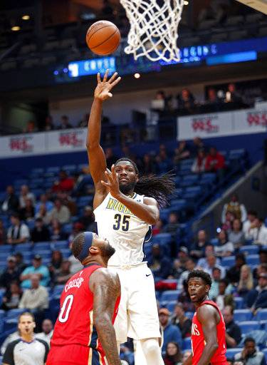 Denver Nuggets forward Kenneth Faried (35) shoots over New Orleans Pelicans center DeMarcus Cousins (0) in the first half of an NBA basketball game in New Orleans, Wednesday, Dec. 6, 2017.