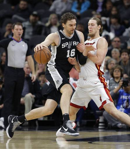 San Antonio Spurs center Pau Gasol (16) drives around Miami Heat center Kelly Olynyk during the first half of an NBA basketball game Wednesday, Dec. 6, 2017, in San Antonio.