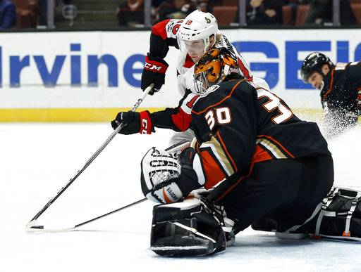 Anaheim Ducks goalie Ryan Miller (30) stops a shot by Ottawa Senators left wing Ryan Dzingel (18) during the first period of an NHL hockey game in Anaheim, Calif., Wednesday, Dec. 6, 2017.