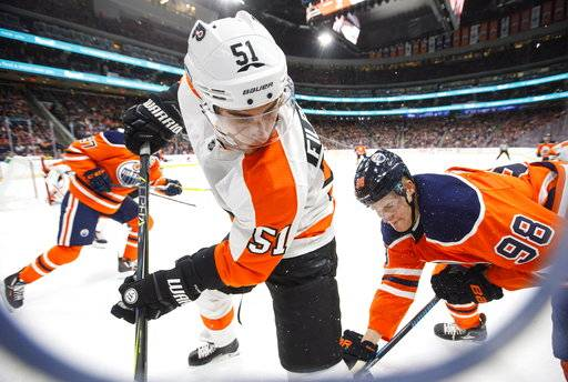 Philadelphia Flyers' Valtteri Filppula (51) battles for the puck with Edmonton Oilers' Jesse Puljujarvi (98) during the second period of an NHL hockey game Wednesday, Dec. 6, 2017, in Edmonton, Alberta. (Jason Franson/The Canadian Press via AP)