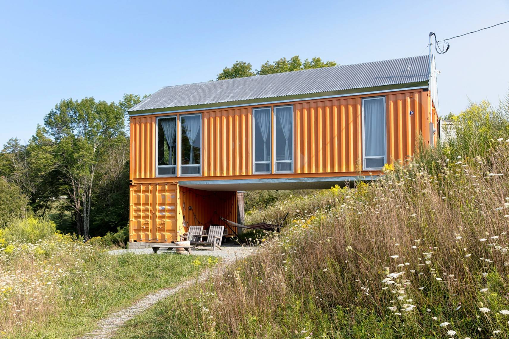 This home, made using steel shipping containers, was designed and built by Steele House along with Bigprototype in Livingston Manor, New York.
