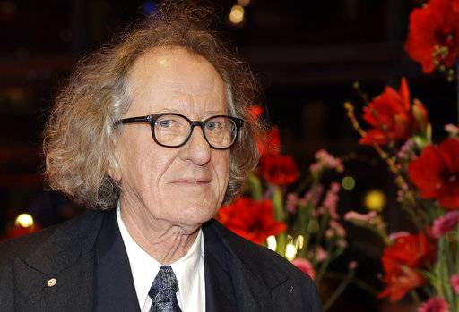 "FILE - In this Saturday, Feb. 11, 2017, file photo, Australian actor Geoffrey Rush arrives for the screening of the film 'Final Portrait' at the 2017 Berlinale Film Festival in Berlin, Germany. Rush is suing a Sydney newspaper for allegedly portraying him as a sexual predator in its reporting of an actress's complaint of ""inappropriate behavior"" against the Oscar-winning actor. (AP Photo/Michael Sohn, File)"
