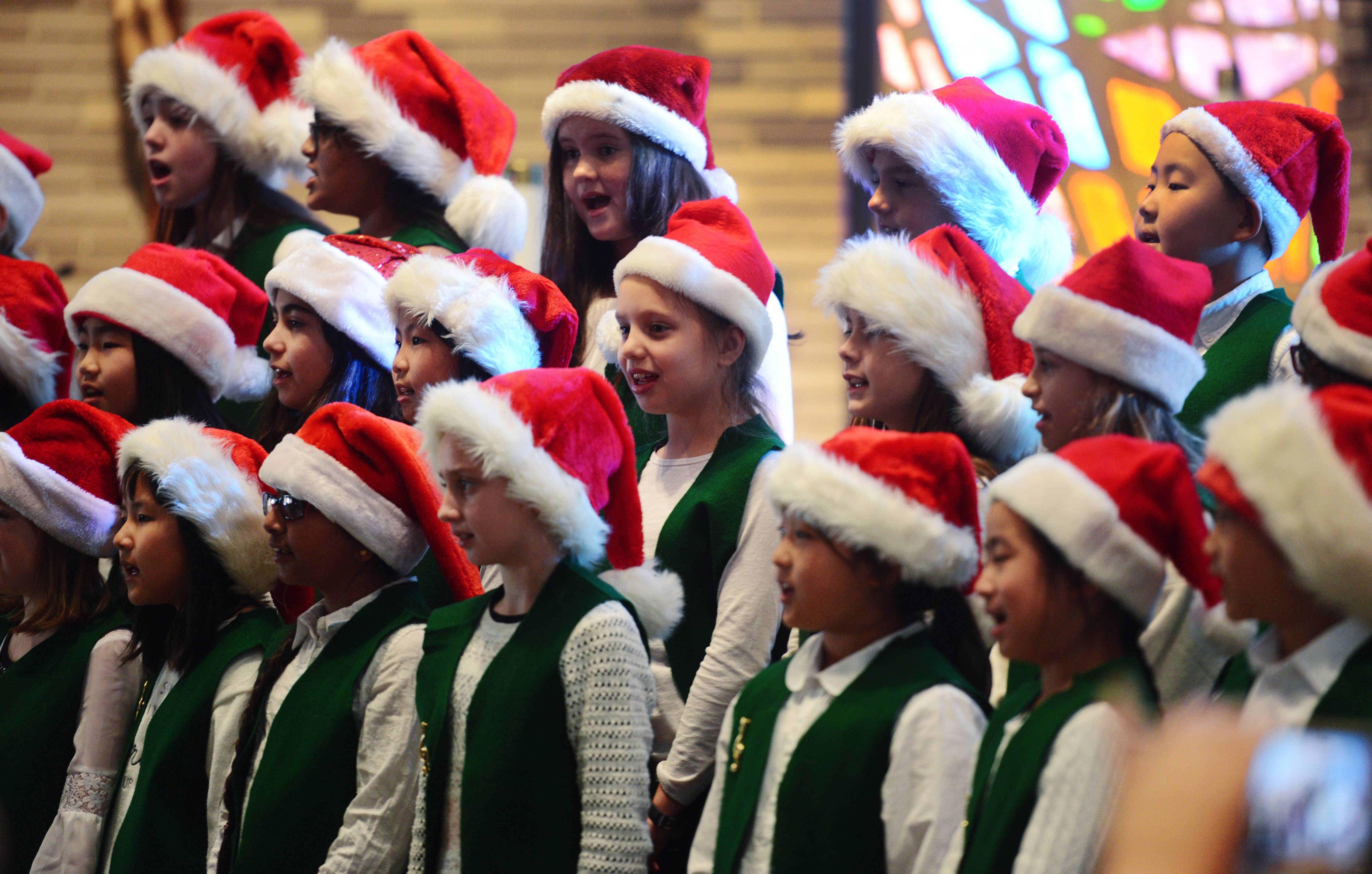 The Greenbrier Gators chorus, consisting of fourth- and fifth-graders, sings during a concert for seniors at Lutheran Home in Arlington Heights Friday.