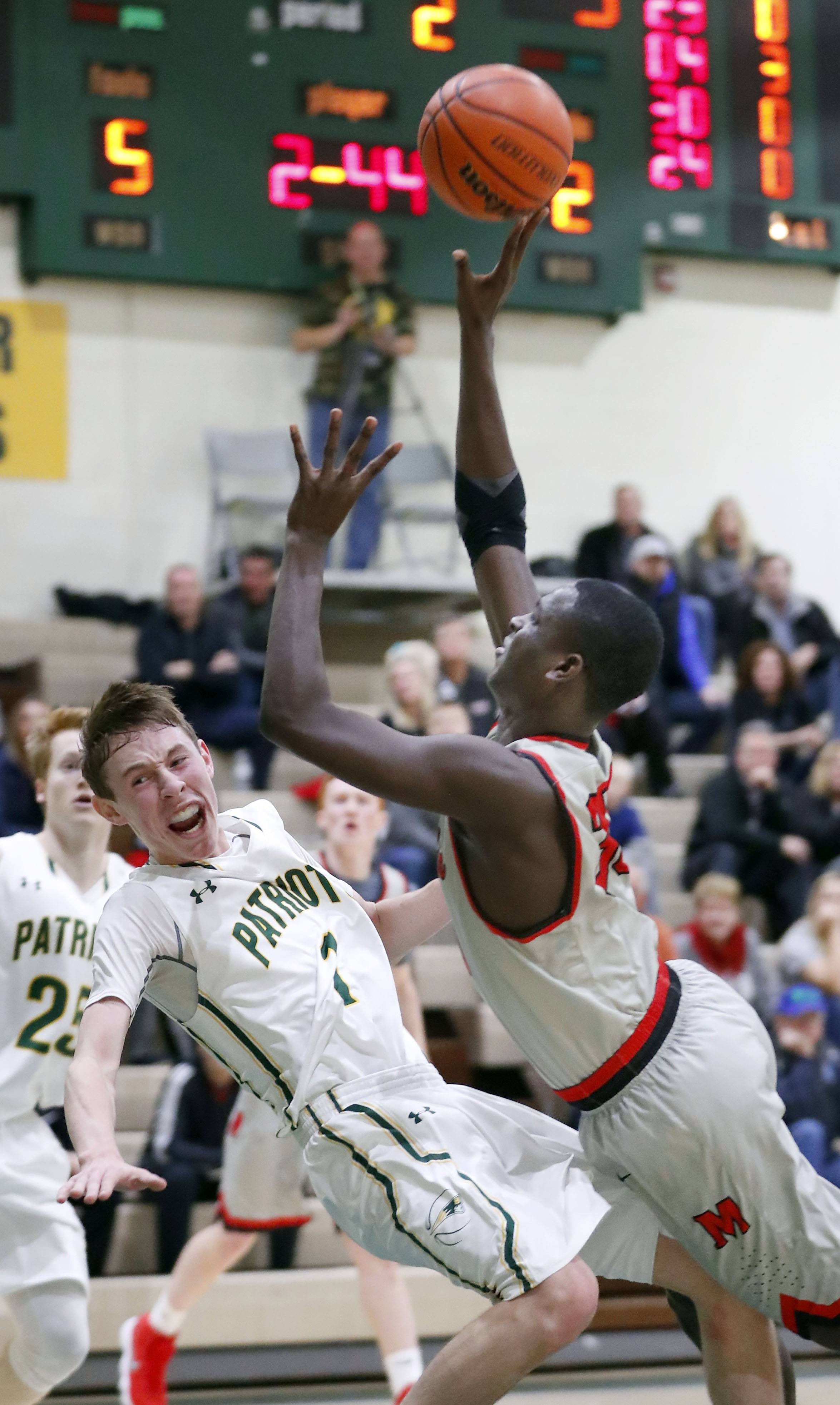 Mundelein's Chibuike Ebube, right, drives on Stevenson's Matthew Ambrose.