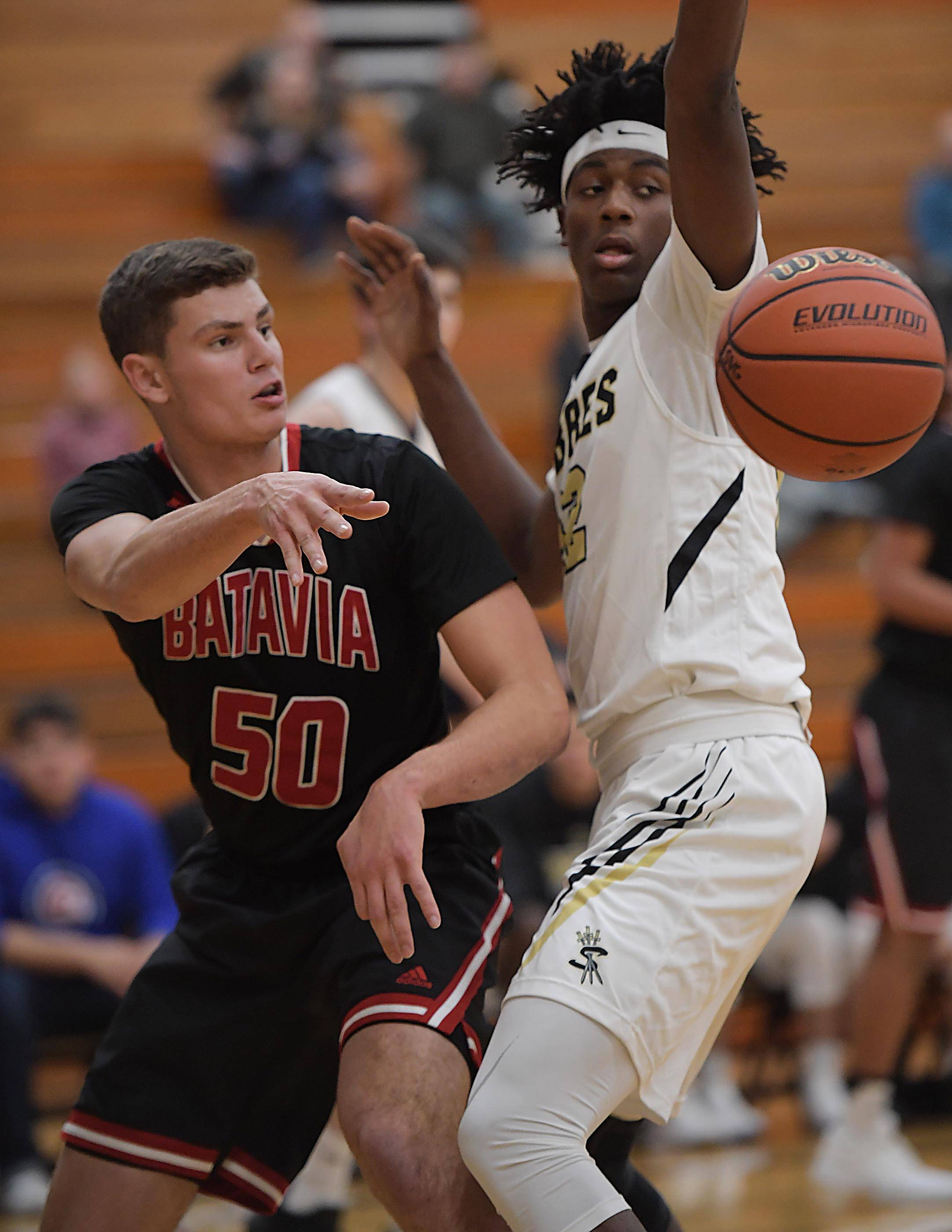 Batavia's Collin Richter passes around Streamwood's Keenan Cole.