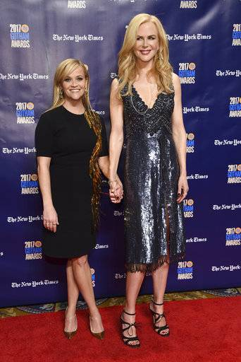 "File-This Nov. 27, 2017, file photo shows Reese Witherspoon, left, and Nicole Kidman arriving at the 27th annual Independent Film Project's Gotham Awards at Cipriani Wall Street in New York. HBO inked Witherspoon and Kidman to new deals for ""Big Little Lies"". (Photo by Evan Agostini/Invision/AP)"