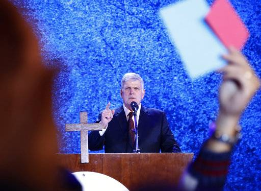 In this Friday, Dec. 8, 2017, photo, evangelical preacher Franklin Graham speaks in front of audience in Hanoi, Vietnam. More than 10,000 Vietnamese have filled up a stadium in a rare Christian evangelistic event led by the Rev. Franklin Graham, who says he wants the communist government to consider Christians its best citizens. (AP Photo/Hau Dinh)