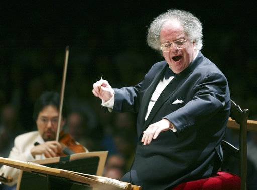 "FILE - In this July 7, 2006 file photo, Boston Symphony Orchestra music director James Levine conducts the symphony on its opening night performance at Tanglewood in Lenox., Mass. Longtime Metropolitan Opera conductor Levine has denied allegations of sexual misconduct and says he wants to resume his work ""with full concentration and inspiration."" ""As understandably troubling as the accusations noted in recent press accounts are, they are unfounded,"" Levine said in a statement issued Thursday, Dec. 7, 2017, to The New York Times . ""As anyone who truly knows me will attest, I have not lived my life as an oppressor or an aggressor."" The opera suspended Levine on Sunday after the Times published accounts from three of the accusers who say that Levine sexually abused them when they were teenagers. A fourth accuser later came forward. (AP Photo/Michael Dwyer, File)"