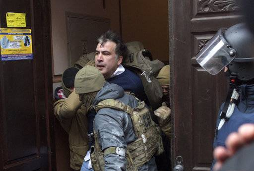 The Ukrainian Security Service officers detain Mikheil Saakashvili at the entrance of his house in Kiev, Ukraine, Tuesday, Dec. 5, 2017. Ukraine's prosecutor-general announced late Friday, Dec. 8, 2017, that opposition figure Mikheil Saakashvili has been arrested. (AP Photo/Evgeniy Maloletka)