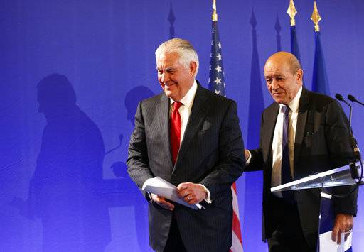 U.S. Secretary of State Rex Tillerson, left, and French Foreign Minister Jean-Yves le Drian leave at a summit convened by France to bolster Lebanon's institutions as it emerges from a bizarre political crisis with regional and international implications. in Paris, Friday, Dec. 8, 2017. It's the first major gathering of key nations to discuss Lebanon's future since a crisis erupted following Hariri's resignation while in Saudi Arabia. (AP Photo/Thibault Camus)