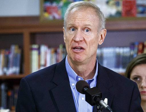 FILE - In this Aug. 30, 2017 file photo, Gov. Bruce Rauner answers questions during a news conference in Springfield, Ill. A state purchasing regulator whom Republican Gov. Rauner now claims is heavily influenced by Democratic House Speaker Michael Madigan was recommended for the post by the governor's office, according to an email obtained by The Associated Press on Friday, Dec. 8, 2017. (Rich Saal/The State Journal-Register via AP, File)