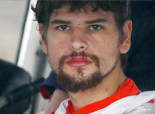 "FILE - In this Sept. 27, 2016, file photo, Nathan Carman arrives in a small boat at the US Coast Guard station in Boston after spending a week at sea in a life raft before being rescued by a passing freighter. Insurance company lawyers on Monday, Sept. 25, 2017, blasted Carman, whose mother was lost at sea, saying he made suspicious alterations to his boat before what they called its ""most curious sinking."" There is a hearing on the insurance claim in Federal Court Friday, Dec. 8, 2017 in Providence, RI. (AP Photo/Michael Dwyer, File)"