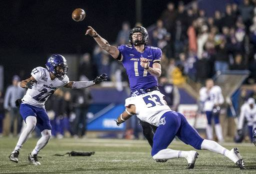 James Madison quarterback Bryan Schor (17) throws a pass as Weber State linebacker Auston Tesch (53) tries to make the sack during the second half of an NCAA college football game in the quarterfinals of the FCS playoffs Friday, Dec. 8, 2017, in Harrisonburg, Va. James Madison won 31-28. (Daniel Lin/Daily News-Record via AP)