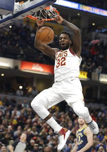 Cleveland Cavaliers' Jeff Green dunks during the first half of the team's NBA basketball game against the Indiana Pacers, Friday, Dec. 8, 2017, in Indianapolis. (AP Photo/Darron Cummings)