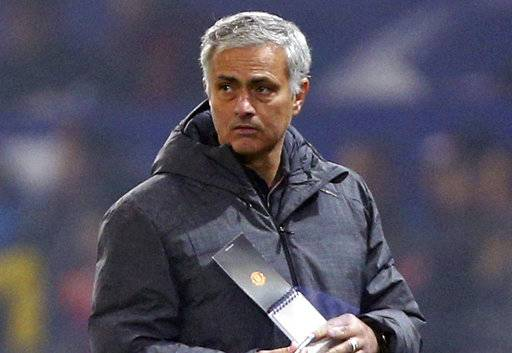 "FILE - In this Tuesday, Oct. 31, 2017 file photo, Manchester United coach Jose Mourinho looks on during their Champions League group A soccer match against Benfica, at Old Trafford, in Manchester, England. Jose Mourinho has noted a weakness in the Manchester City team that has swatted aside all-comers in the Premier League this season. ""If you ask me one thing that I don't like a lot, it's that they lose the balance very easily,� the Manchester United manager said Friday, Dec. 8 two days before his team's match against unbeaten leader City at Old Trafford. ""A little bit of wind and they fall.�(AP Photo/Dave Thompson, file)"