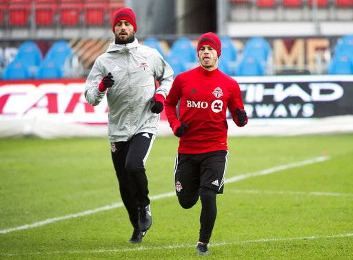 Toronto FC midfielder Victor Vazquez, left, and forward Sebastian Giovinco warm up during practice ahead of the MLS Cup soccer final against the Seattle Sounders, in Toronto, Friday, Dec. 8, 2017. (Nathan Denette/The Canadian Press via AP)