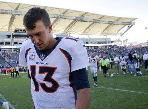 FILE - In this Oct. 22, 2017, file photo, Denver Broncos quarterback Trevor Siemian walks off the field after a 21-0 loss against the Los Angeles Chargers in an NFL football game in Carson, Calif. Broncos coach Vance Joseph is sticking with Siemian at quarterback. There aren't that many options as the Broncos try to snap an eight-game skid Sunday against the New York Jets.(AP Photo/Jae C. Hong, File)