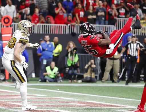 Atlanta Falcons middle linebacker Deion Jones (45) intercepts a ball in the end zone ahead of New Orleans Saints tight end Josh Hill (89) during the second half of an NFL football game, Thursday, Dec. 7, 2017, in Atlanta. The Falcons won 20-17. (AP Photo/David Goldman)